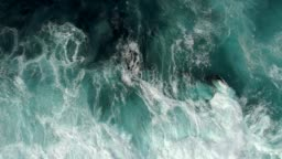 Real time shot of sea surf. Aerial top down view