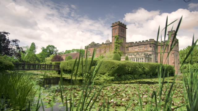real time timelapse of beautiful moat surrounding restored castle