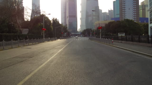 real time traffic in the lujiazui financial district - empty road stock videos & royalty-free footage