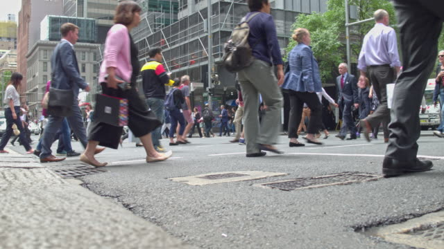 real time video of a busy crosswalk at business district of sydney - crossing stock videos & royalty-free footage