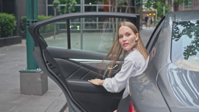 real time video of businesswoman leaving taxi in melbourne downtown - getting out stock videos & royalty-free footage