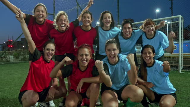 real time video of cheering female footballers at twilight - sports team stock videos & royalty-free footage