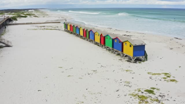 real time video of colourful beach houses at muizenberg beach, cape town, south africa - hut stock videos & royalty-free footage