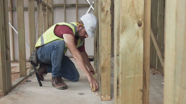 real time video of construction worker measuring at site - one man only stock videos & royalty-free footage