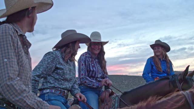 real time video of cowgirls talking and having fun enjoying horseback riding in the fields at dusk - horseback riding stock videos & royalty-free footage