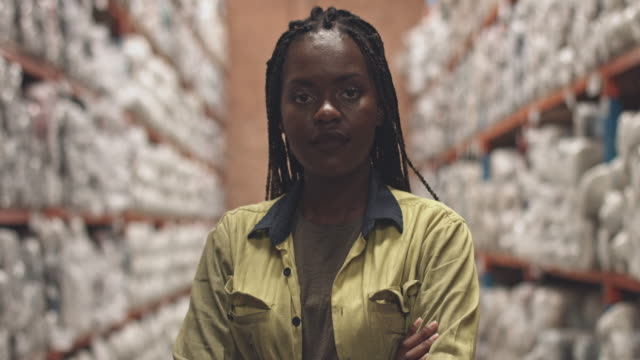 Real time video of female worker in aisle at warehouse