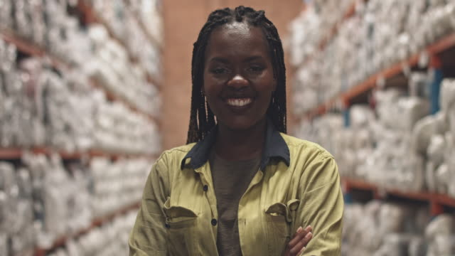 real time video of happy female worker in aisle at warehouse - place of work stock videos & royalty-free footage