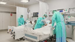 Real time video of healthcare workers taking care of patients in ICU.