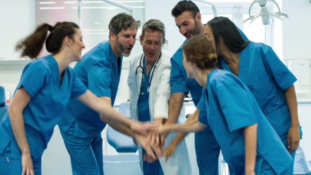 real time video of medical team celebrating after a hard day - coworker stock videos & royalty-free footage