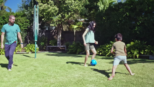 real time video of multi-ethnic australian family playing  at the backyard garden - australia stock videos & royalty-free footage