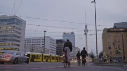Real time video of people cycling in Berlin at dusk, Germany