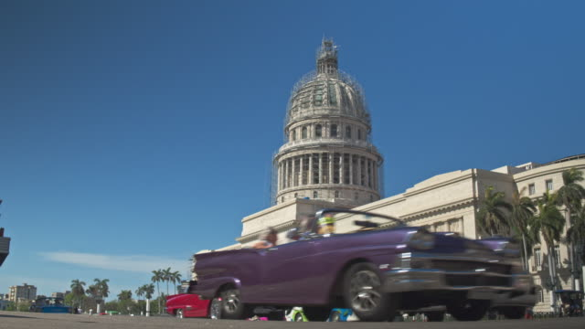 real time video of traffic cars in havana with capitol building in the background - collector's car stock videos & royalty-free footage