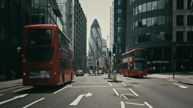real time video of vehicles moving on street against 30 st mary axe - london england stock videos and b-roll footage