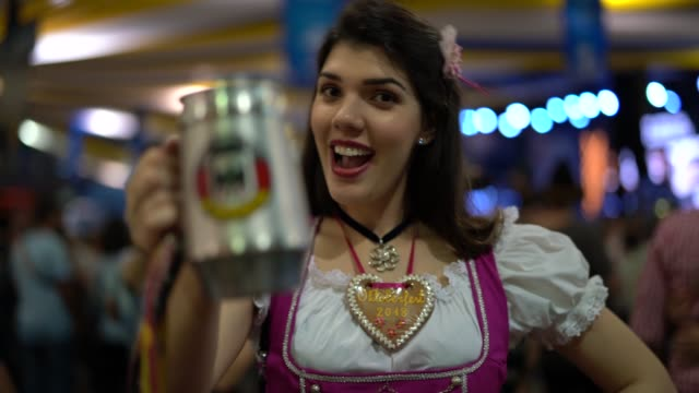 real woman celebratory beer toast at oktoberfest - portrait - traditional clothing stock videos & royalty-free footage