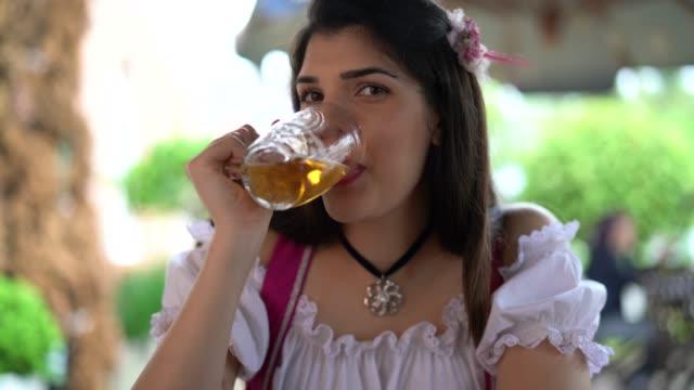 real woman celebratory beer toast at pub - oktoberfest stock videos & royalty-free footage