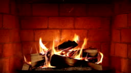 Real Wood Fire Burning in a Clean Brick Fireplace