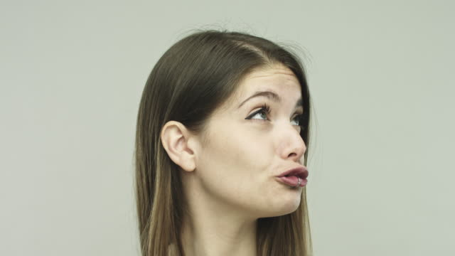 real young woman making duck face - grimacing stock videos and b-roll footage