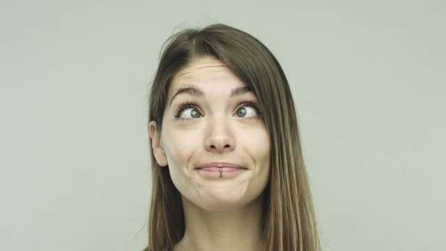 real young woman making funny face - grimacing stock videos & royalty-free footage