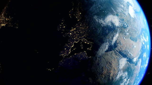 realistic earth city lights from the space and sunrise - europe stock videos & royalty-free footage