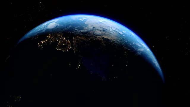 realistiska earth city lights från rymden och sunrise - spinna bildbanksvideor och videomaterial från bakom kulisserna