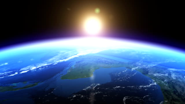 stockvideo's en b-roll-footage met realistic earth & sunrise seen from space - zonsopgang