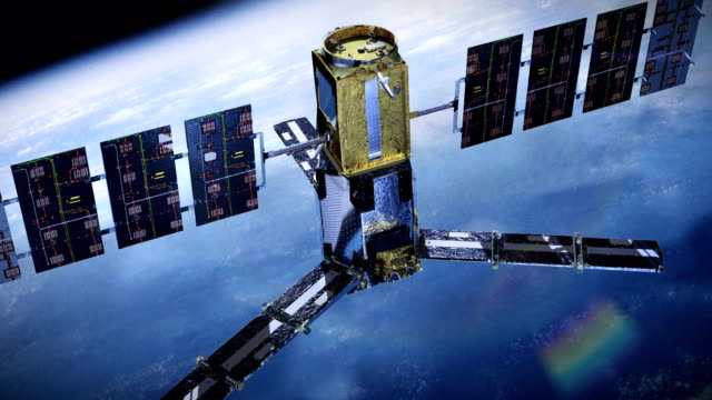 realistico satellite di telecomunicazione - satellite video stock e b–roll