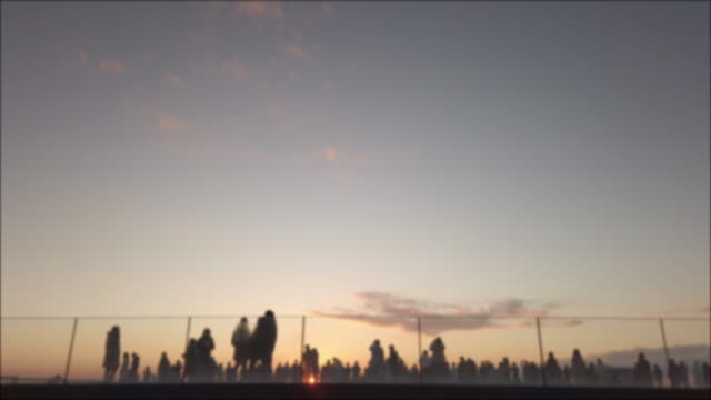 4k realtime . silhouette crowd at rooftop at sunset. - group of people stock videos & royalty-free footage