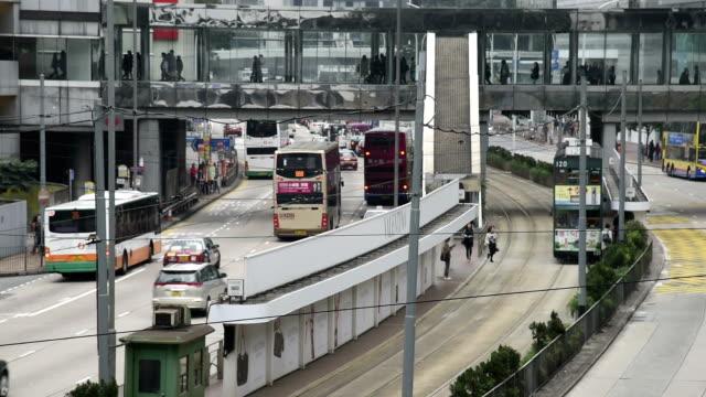 hd real-time video , cityscape of hong kong , busy traffic shuttle traffic - 路面軌道点の映像素材/bロール