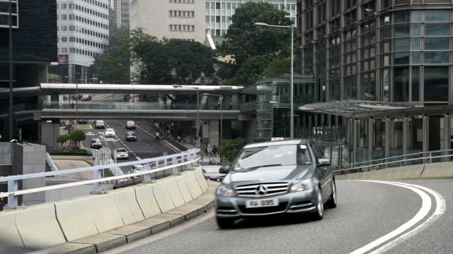 hd real-time video , cityscape of hong kong , busy traffic shuttle traffic - moving past点の映像素材/bロール