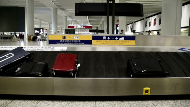 hd real-time video , in the hong kong airport baggage carousel - baggage claim stock videos and b-roll footage