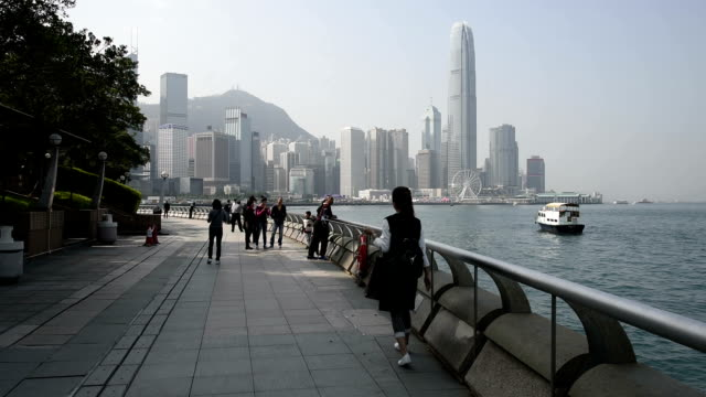 hd real-time video , near the city of hong kong's victoria harbour scenery - promenade stock videos & royalty-free footage