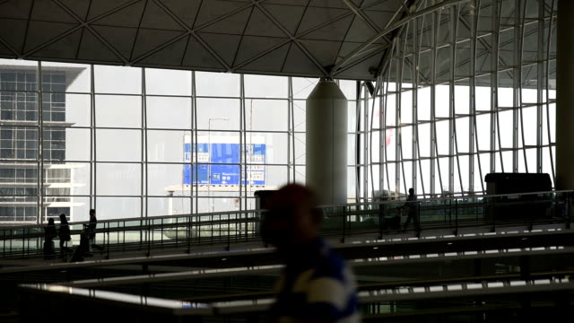 hd real-time video , the hong kong international airport terminal hall crowd shuttle - hong kong international airport stock videos and b-roll footage