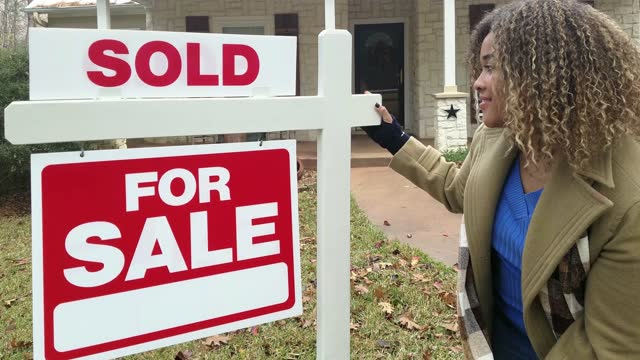 realtor.  home for sale with real estate sign.  front yard. - selling stock videos & royalty-free footage