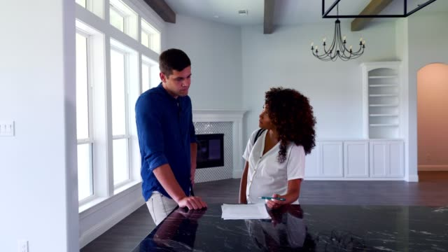 realtor reviews lease agreement with male client - lease agreement stock videos & royalty-free footage