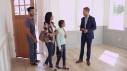 Realtor Showing Family Around New Home Shot On R3D