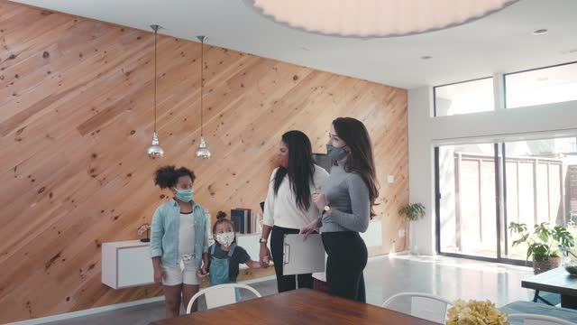 realtor shows home to single mom and her children - selling stock videos & royalty-free footage