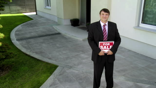 HD CRANE: Realtor With A Real Estate Sign
