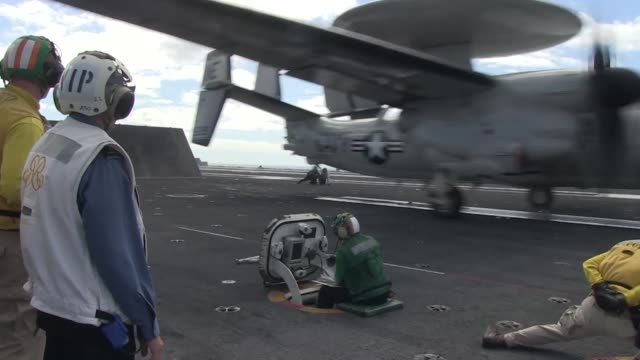 rear admiral giles courturier takes part in a vip visit of the uss ronald reagan as it participates in the rim of the pacific exercise 2014 twentytwo... - 海軍点の映像素材/bロール