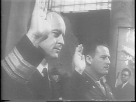 rear admiral thomas inglis and colonel bernard theilen stand before a senate committee their right hands raised as they take an oath / colonel... - alben w. barkley stock videos and b-roll footage
