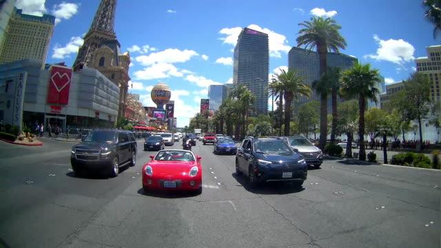 rear camera point of view of driving in las vegas - replica della torre eiffel di las vegas video stock e b–roll