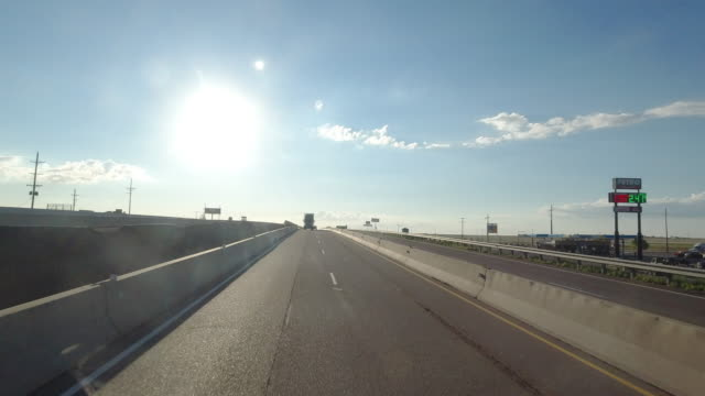 stockvideo's en b-roll-footage met rear camera point of view of driving on highway 40 passing road construction site in amarillo, texas, usa amid the 2020 global coronavirus pandemic - benzineprijzen