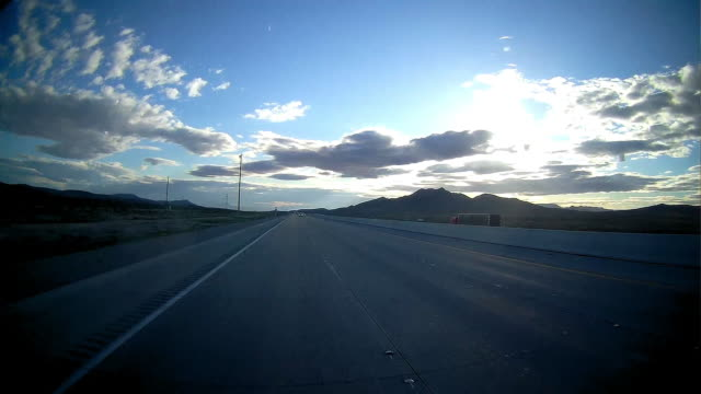 rear camera point of view of highway driving in the morning - vista posteriore video stock e b–roll
