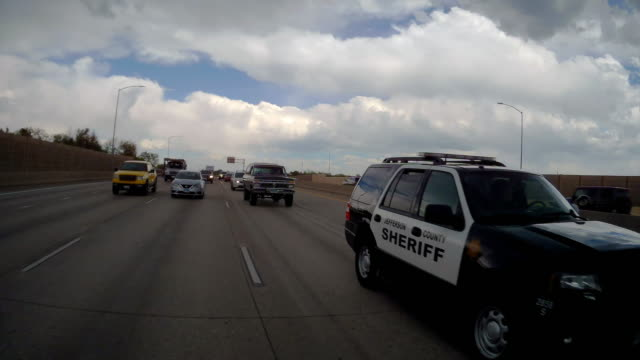 rear camera point of view of police car in jammed traffic in denver, colorado - pursuit concept video stock e b–roll