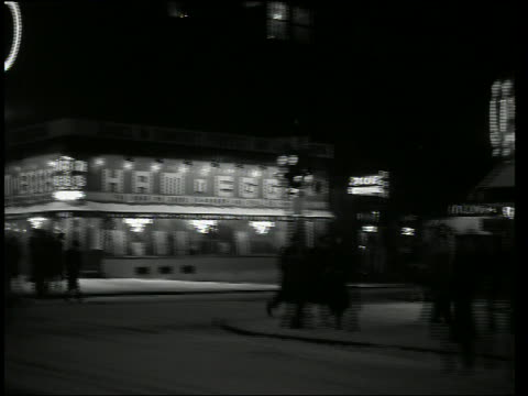 b/w rear car point of view past theatres in nyc at night in winter - broadway manhattan stock videos & royalty-free footage