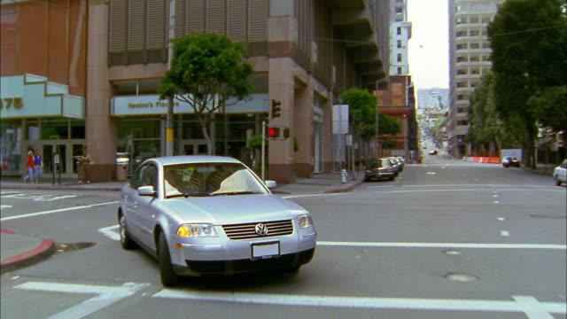 Rear car point of view traffic on street / San Francisco