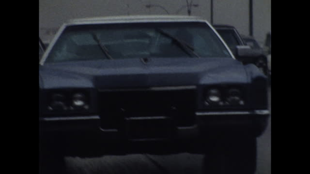 vídeos y material grabado en eventos de stock de rear pov of cars driving through heavy rain; 1971 - 1971