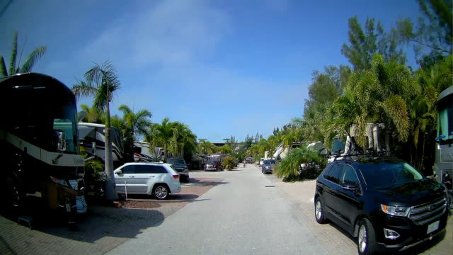rear dashboard camera point of view of driving through a rv resort in florida - tampa stock videos & royalty-free footage