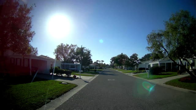 rear dashboard camera point of view of driving through a subdivision in florida - tampa stock videos & royalty-free footage