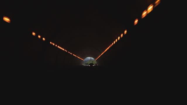 rear pov driving through a tunnel near san francisco - 乗物後部から見た視点点の映像素材/bロール