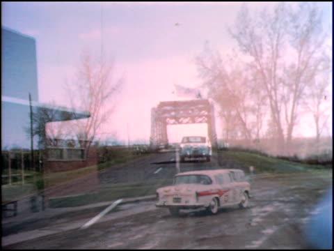 vídeos de stock e filmes b-roll de shot rear end of 1957 nash rambler six custom fourdoor sedan asi it drives on highway rambler starts to pull away from camera / ws roadside canada... - 1957
